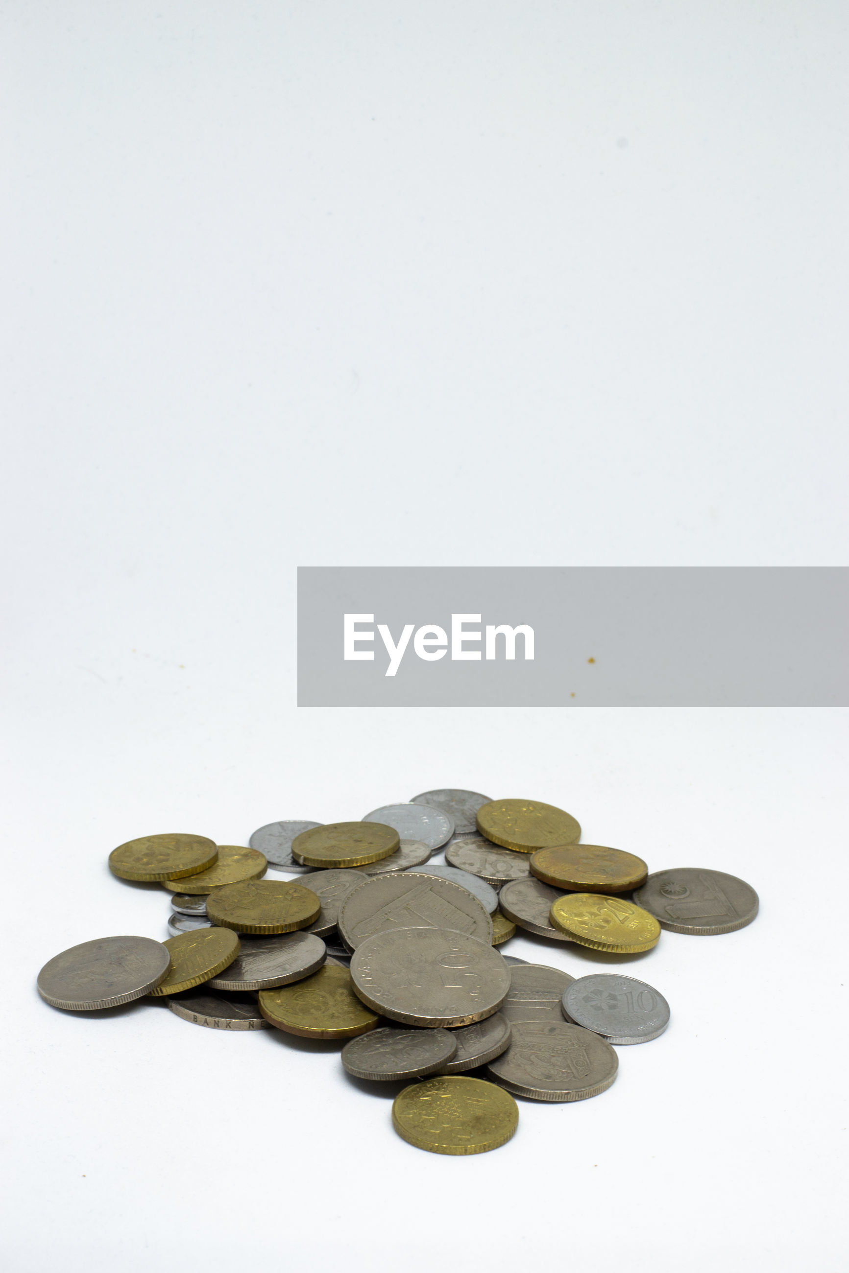 Coins against white background