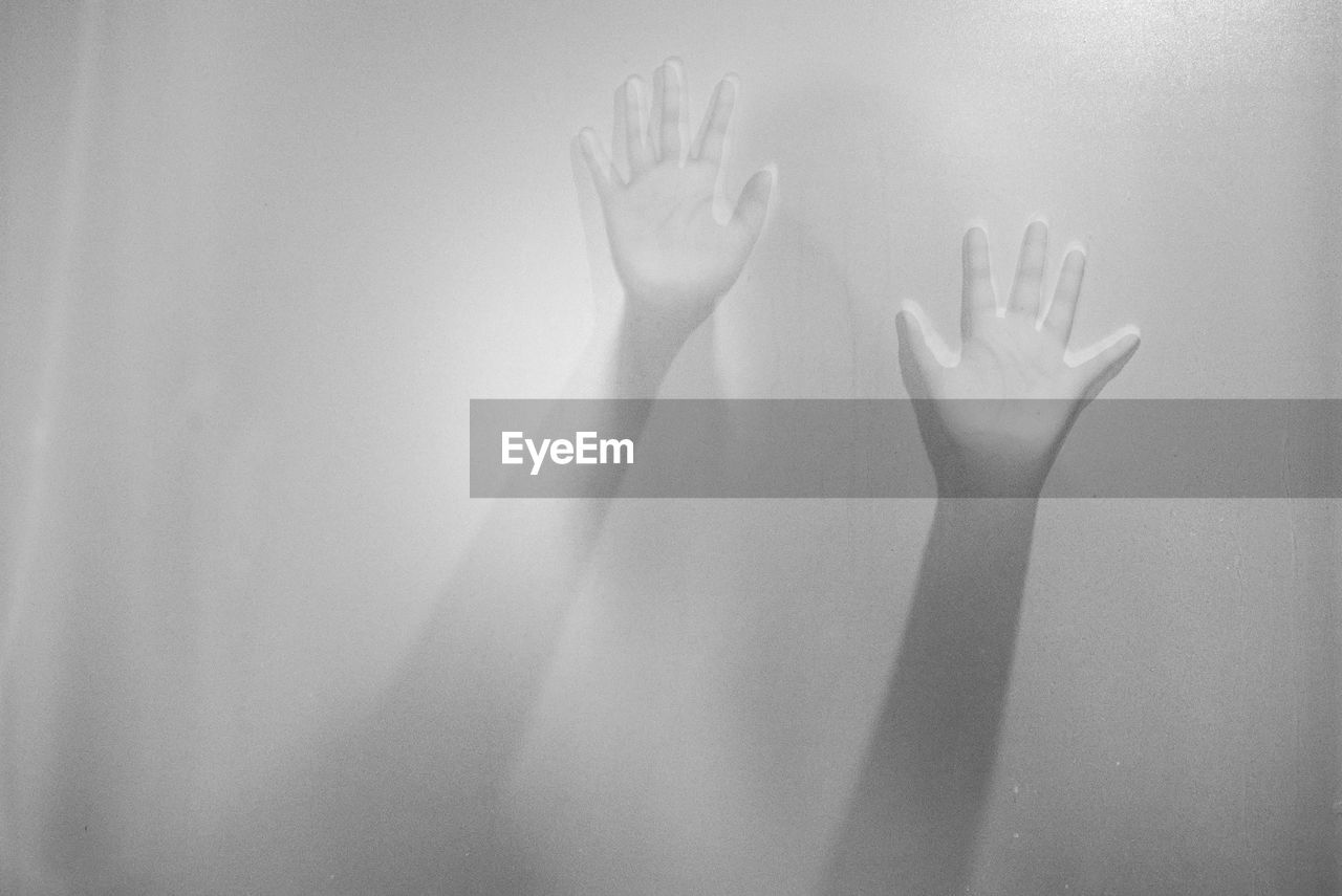 Woman Hands Seen From Frosted Glass Window