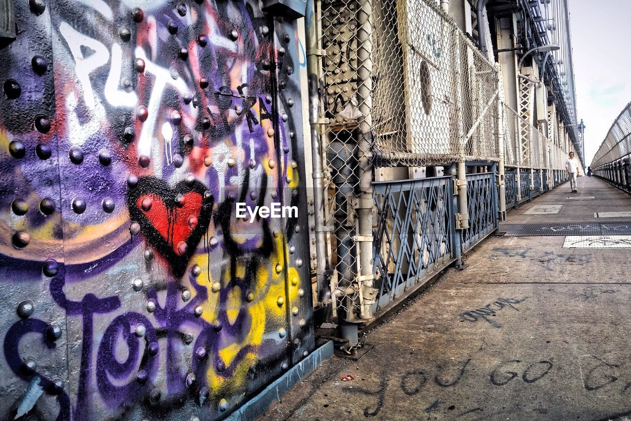 Graffiti On Manhattan Bridge By Walkway Against Clear Sky