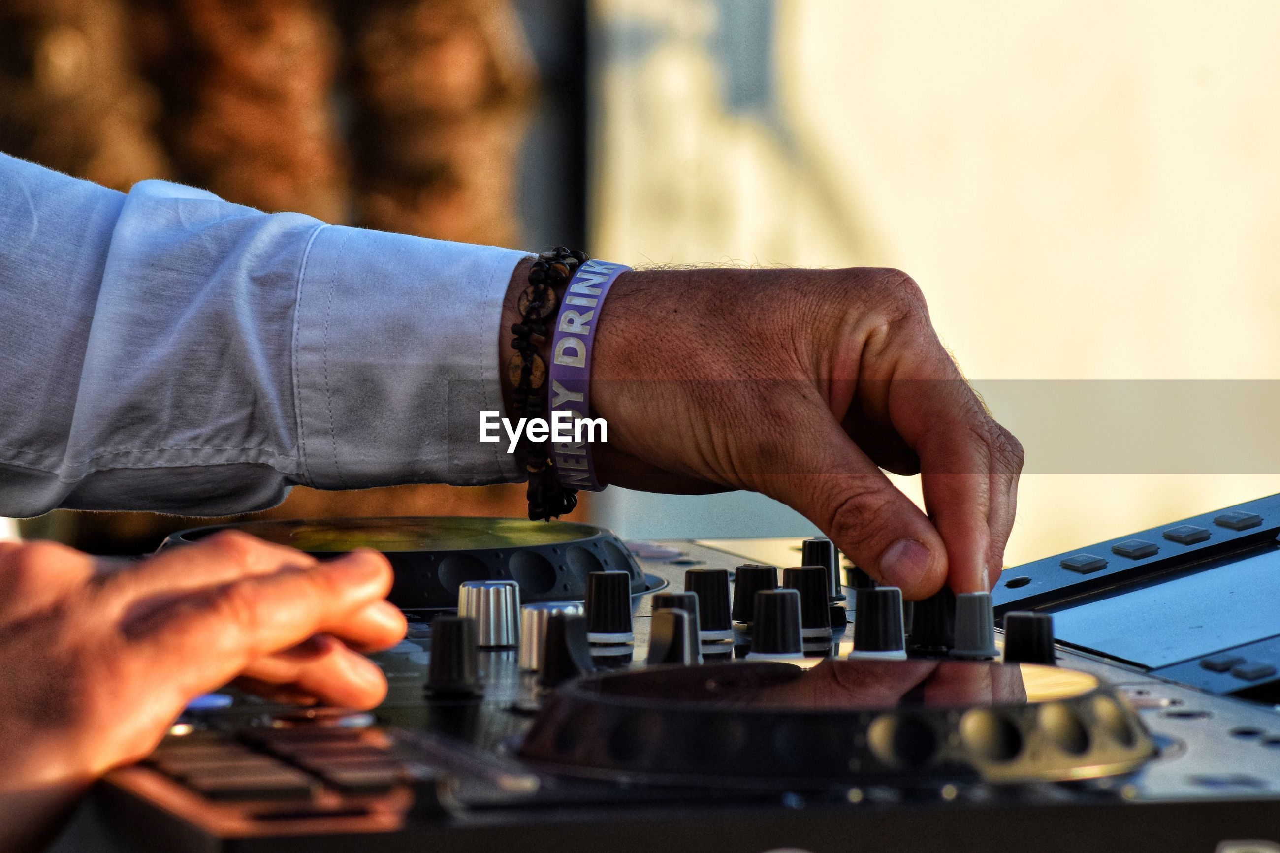 Cropped of hand playing turntable at concert