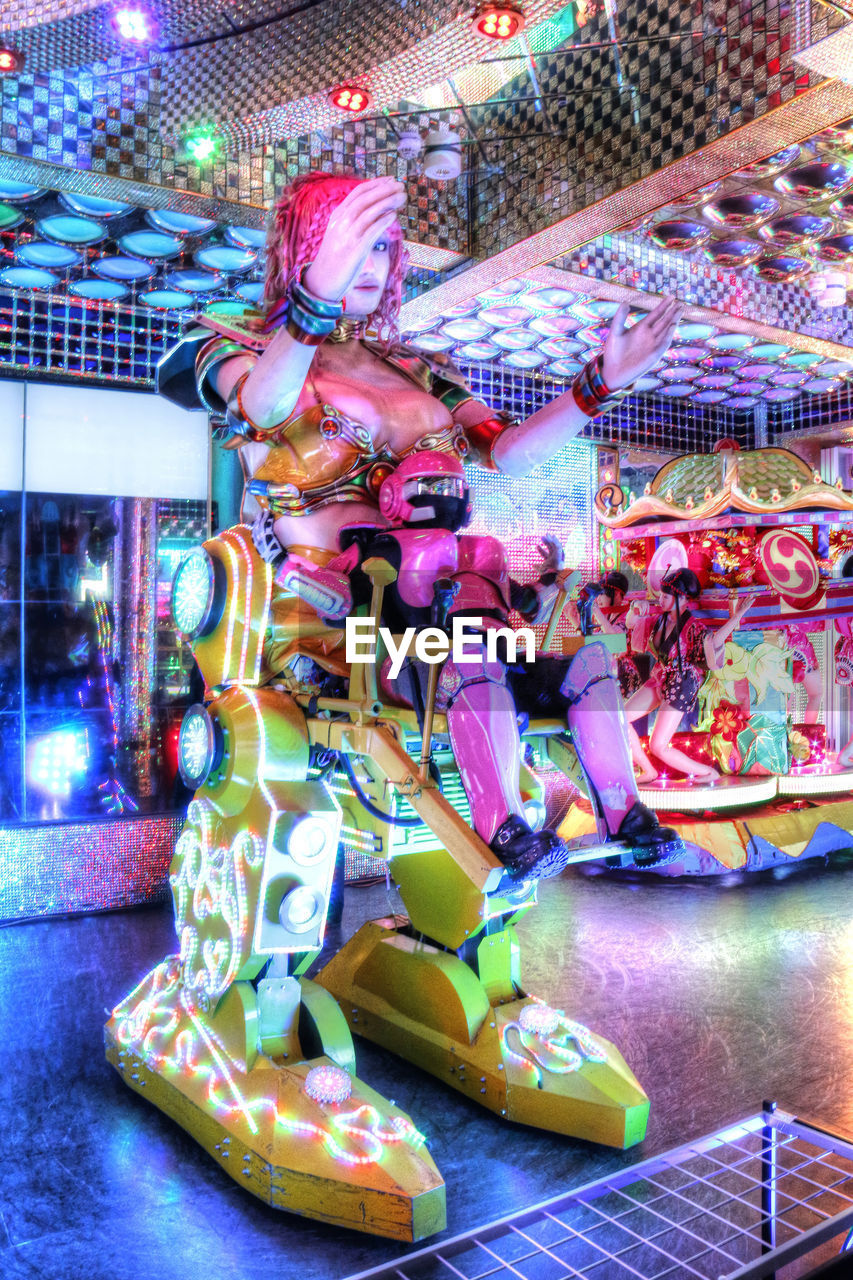 amusement park, multi colored, arts culture and entertainment, amusement park ride, fun, illuminated, carousel, enjoyment, leisure activity, carousel horses, traveling carnival, no people, indoors, merry-go-round, full length, night, close-up