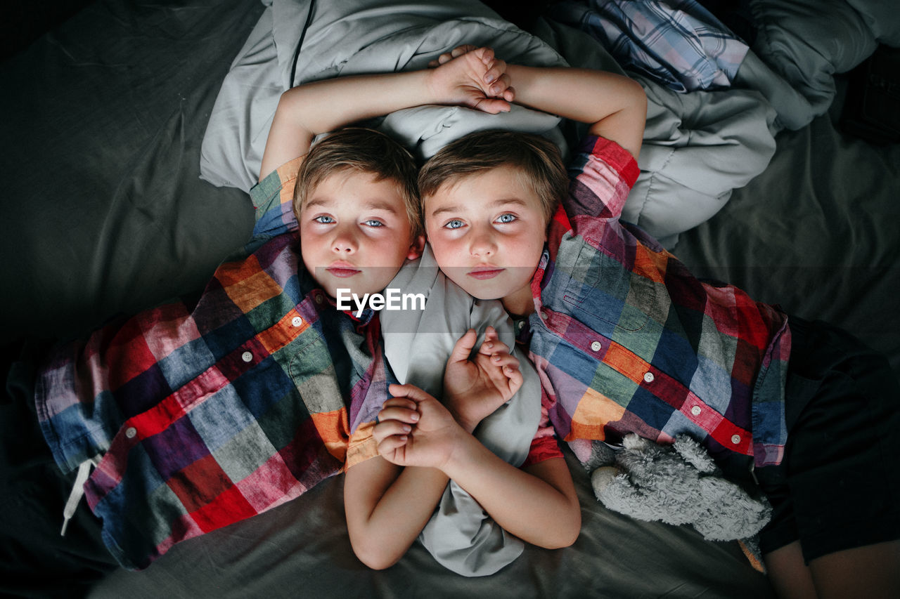 Portrait of boys on bed