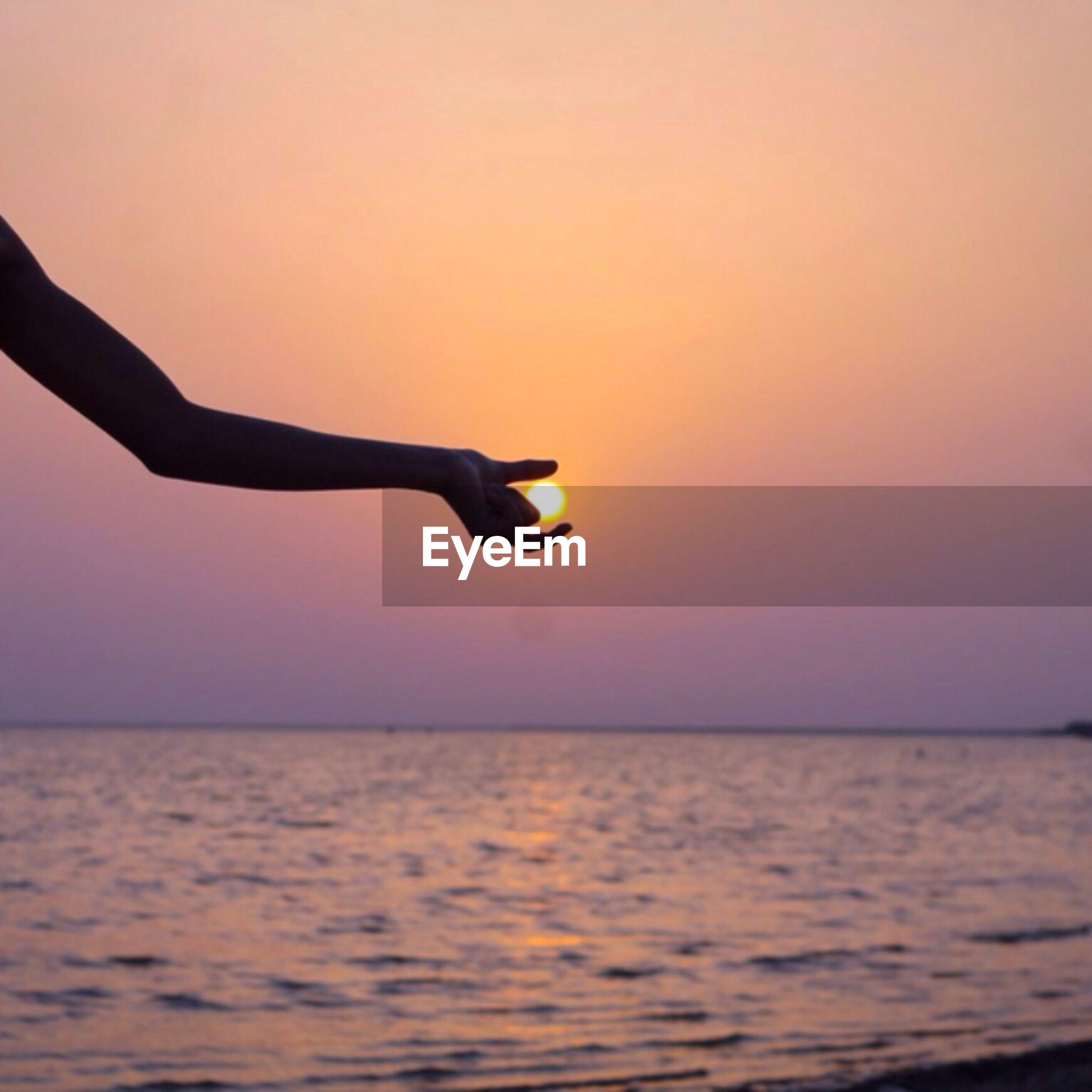 sea, horizon over water, water, sunset, scenics, waterfront, tranquil scene, idyllic, person, tranquility, unrecognizable person, beauty in nature, vacations, lifestyles, dusk, sun, nature, tourism, sky, orange color, calm, travel destinations, non-urban scene, dramatic sky, vibrant color, seascape, ocean, outdoors