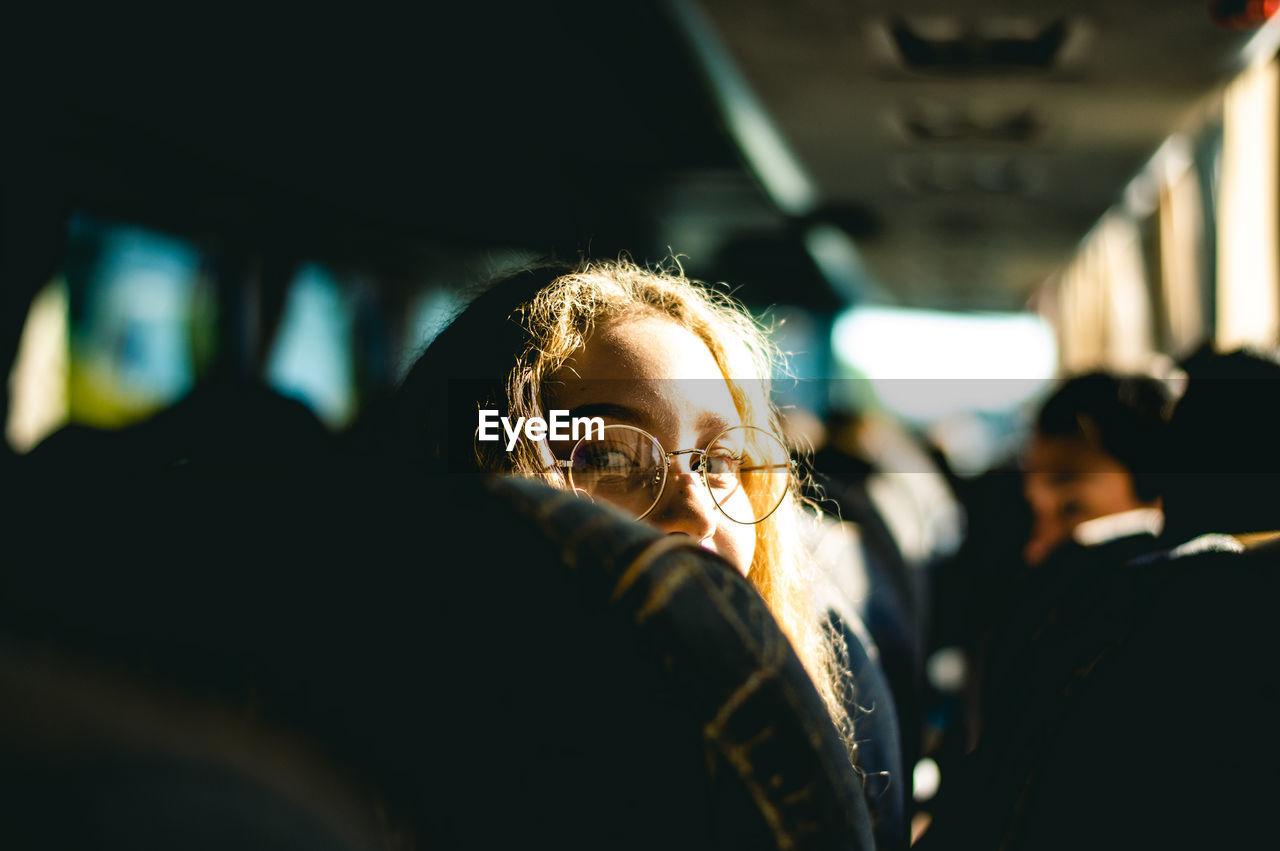 Portrait of woman sitting in bus