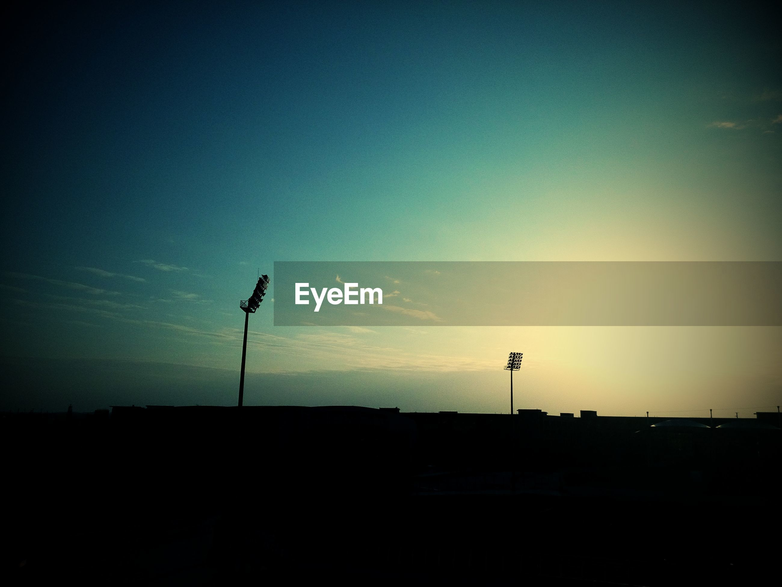 silhouette, sunset, copy space, street light, sky, tranquility, clear sky, dusk, tranquil scene, landscape, dark, scenics, beauty in nature, nature, outline, blue, lighting equipment, outdoors, no people, road