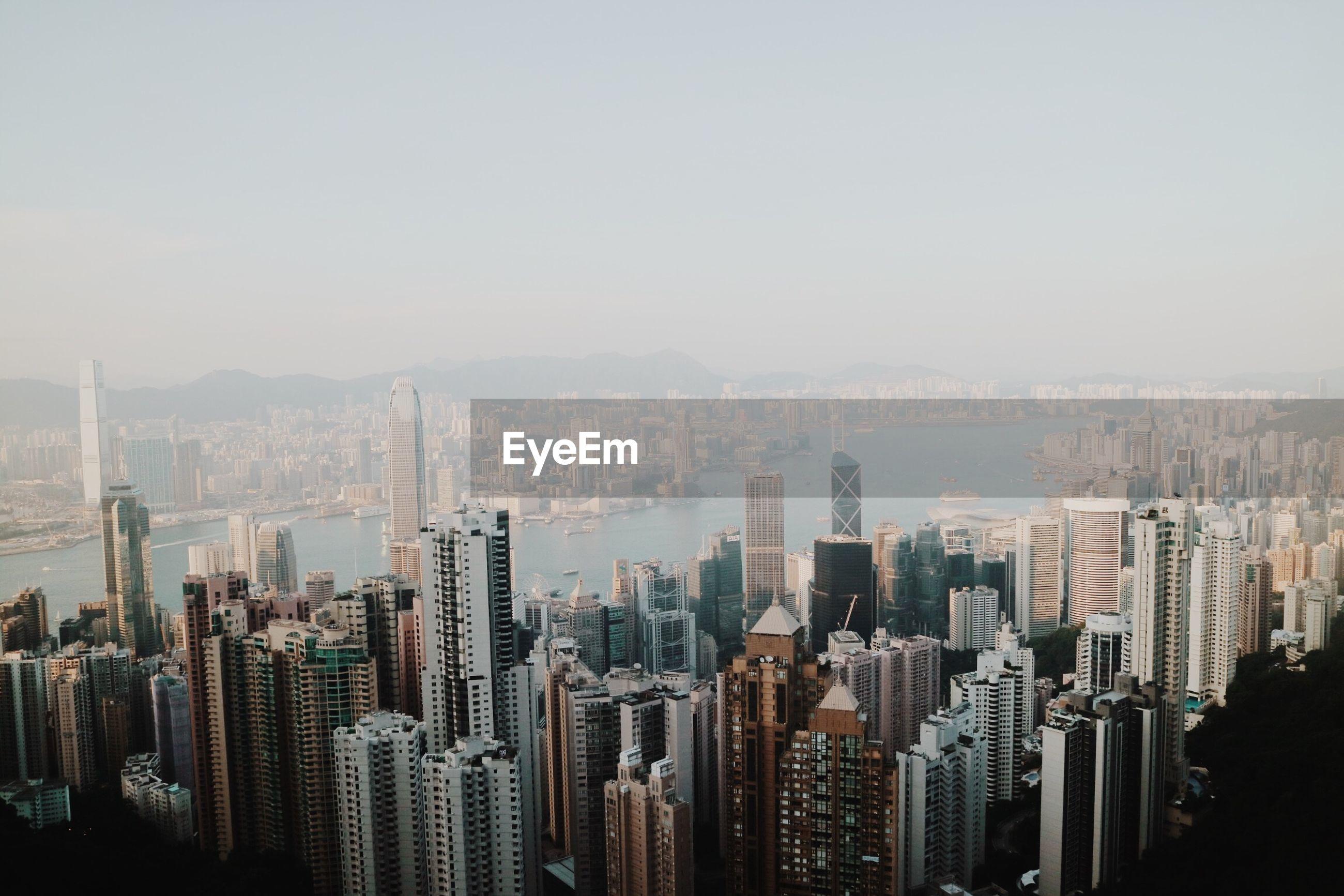 AERIAL VIEW OF MODERN BUILDINGS AGAINST CLEAR SKY