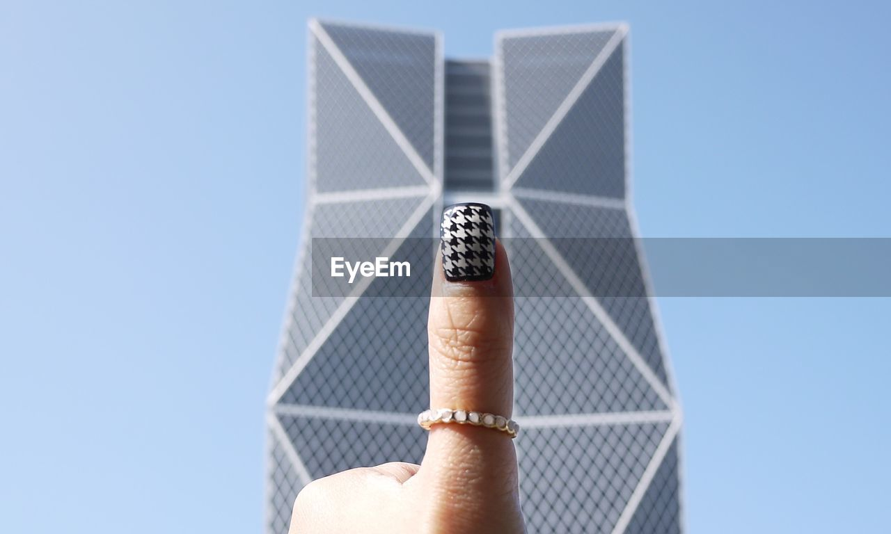 Cropped Image Of Woman Hand With Nail Art Against China Steel