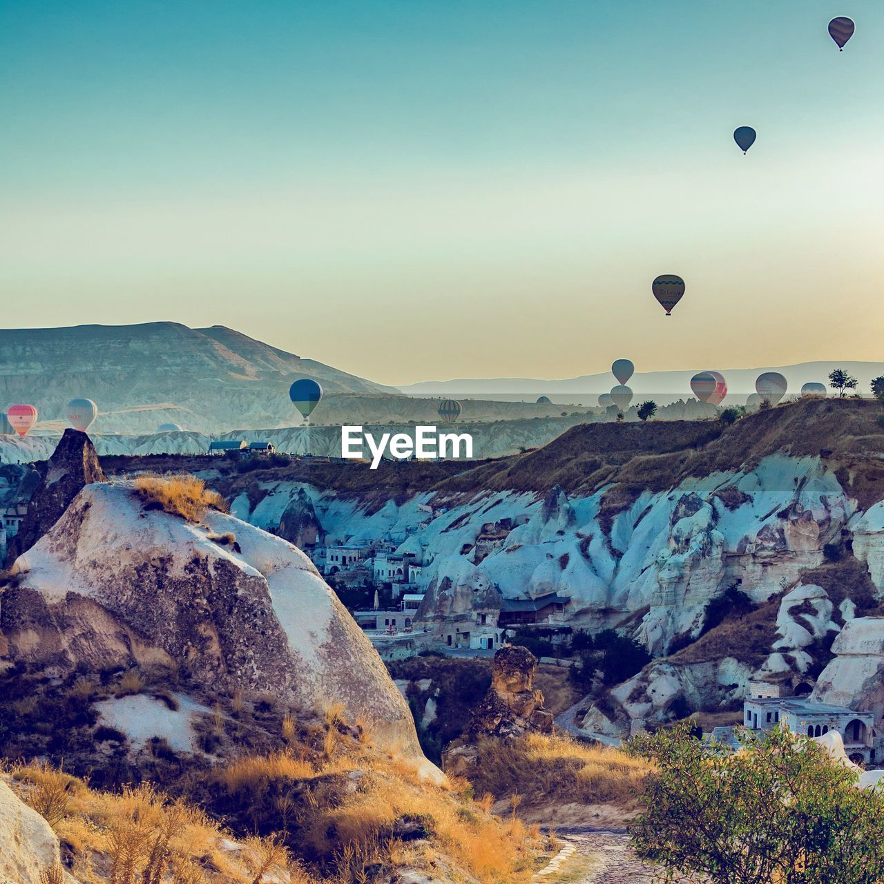 nature, mountain, landscape, rock - object, beauty in nature, tranquil scene, outdoors, no people, scenics, tranquility, physical geography, sky, day, hot air balloon