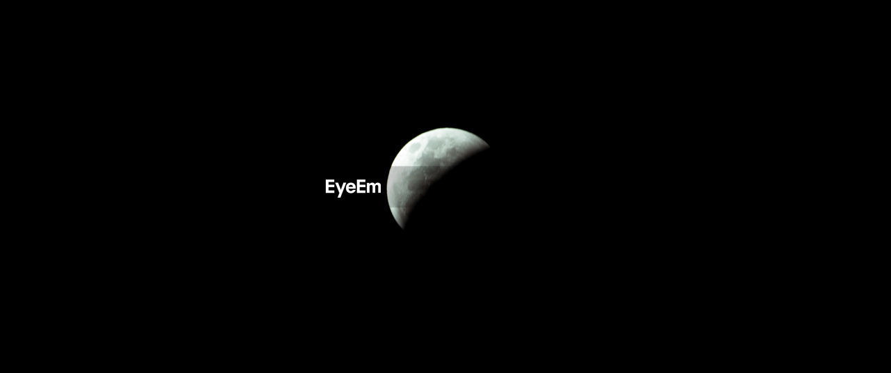 copy space, moon, no people, astronomy, night, beauty in nature, black background, space, planetary moon, sky, half moon, studio shot, nature, low angle view, moon surface, cut out, tranquility, outdoors, dark, idyllic, moonlight, eclipse