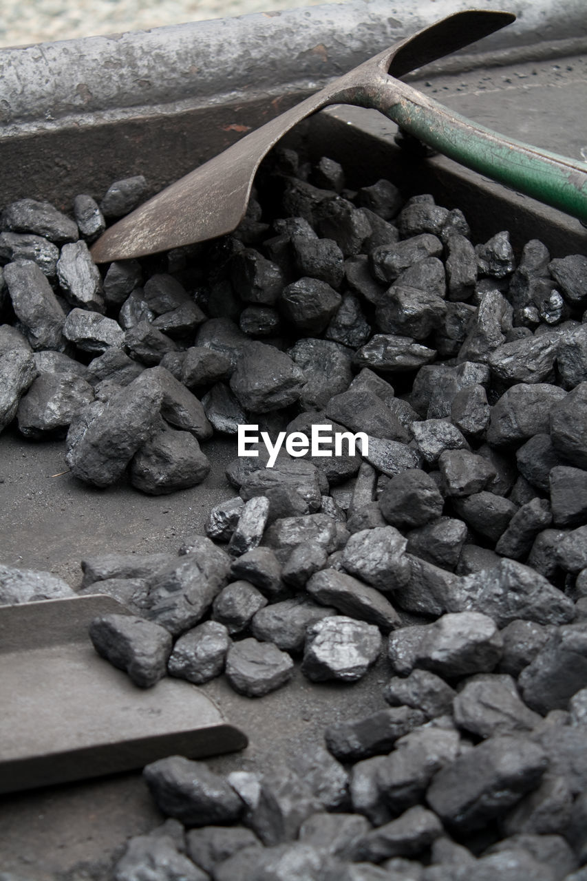 High Angle View Of Coals And Shovel