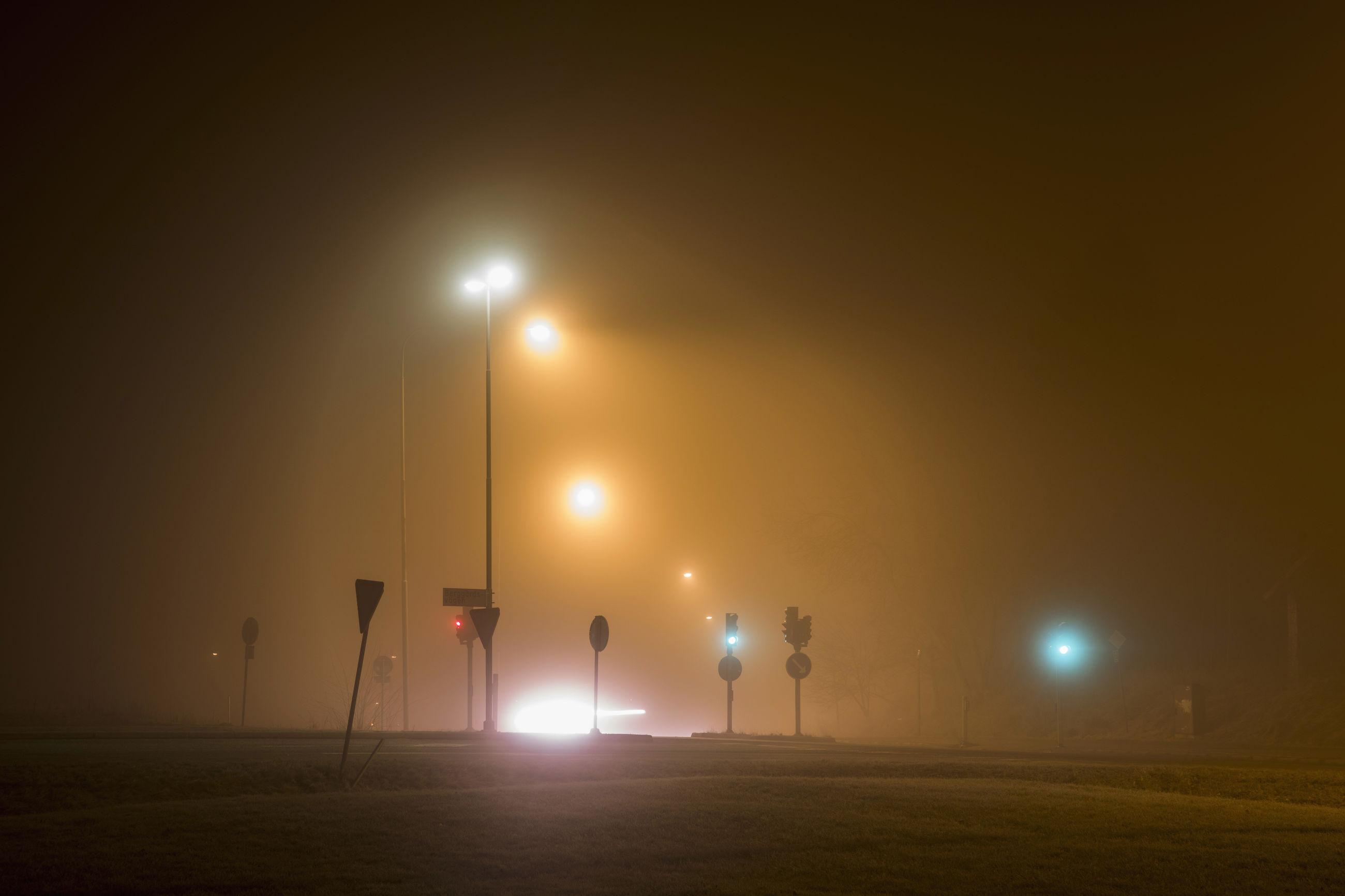 ILLUMINATED STREET LIGHT AGAINST SKY DURING NIGHT