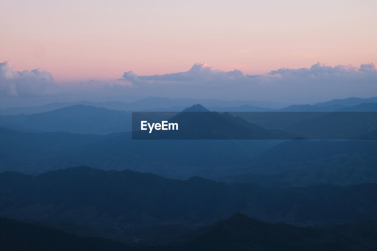 nature, sunset, beauty in nature, tranquil scene, tranquility, mountain, scenics, sky, silhouette, outdoors, no people, mountain range, landscape, fog, hazy, day