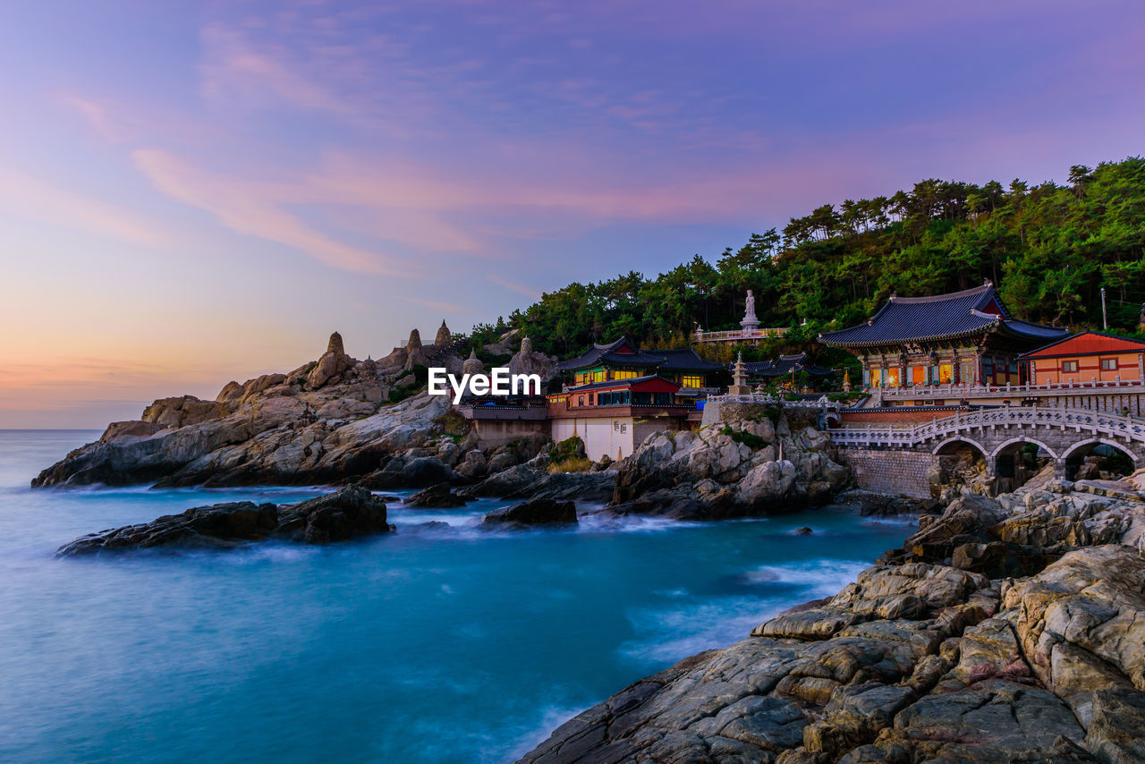 water, rock, rock - object, sky, sea, solid, built structure, scenics - nature, beauty in nature, architecture, sunset, nature, building exterior, building, rock formation, motion, cloud - sky, land, no people, outdoors