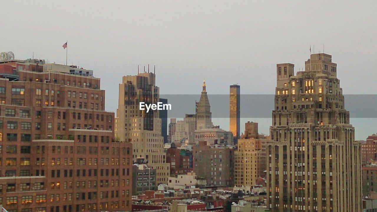 Skyscrapers buildings in city against clear sky