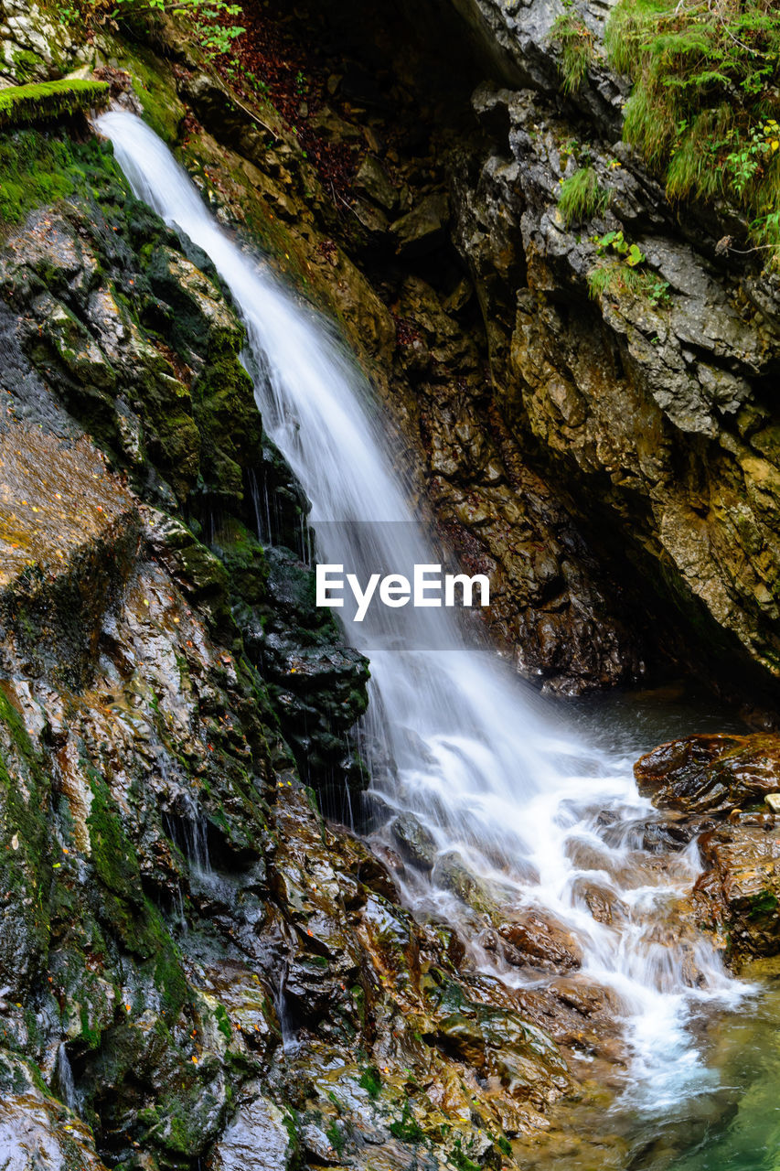 motion, water, scenics - nature, long exposure, flowing water, beauty in nature, waterfall, rock formation, rock, blurred motion, tree, rock - object, power, non-urban scene, solid, power in nature, forest, nature, moss, no people, flowing, falling water, outdoors
