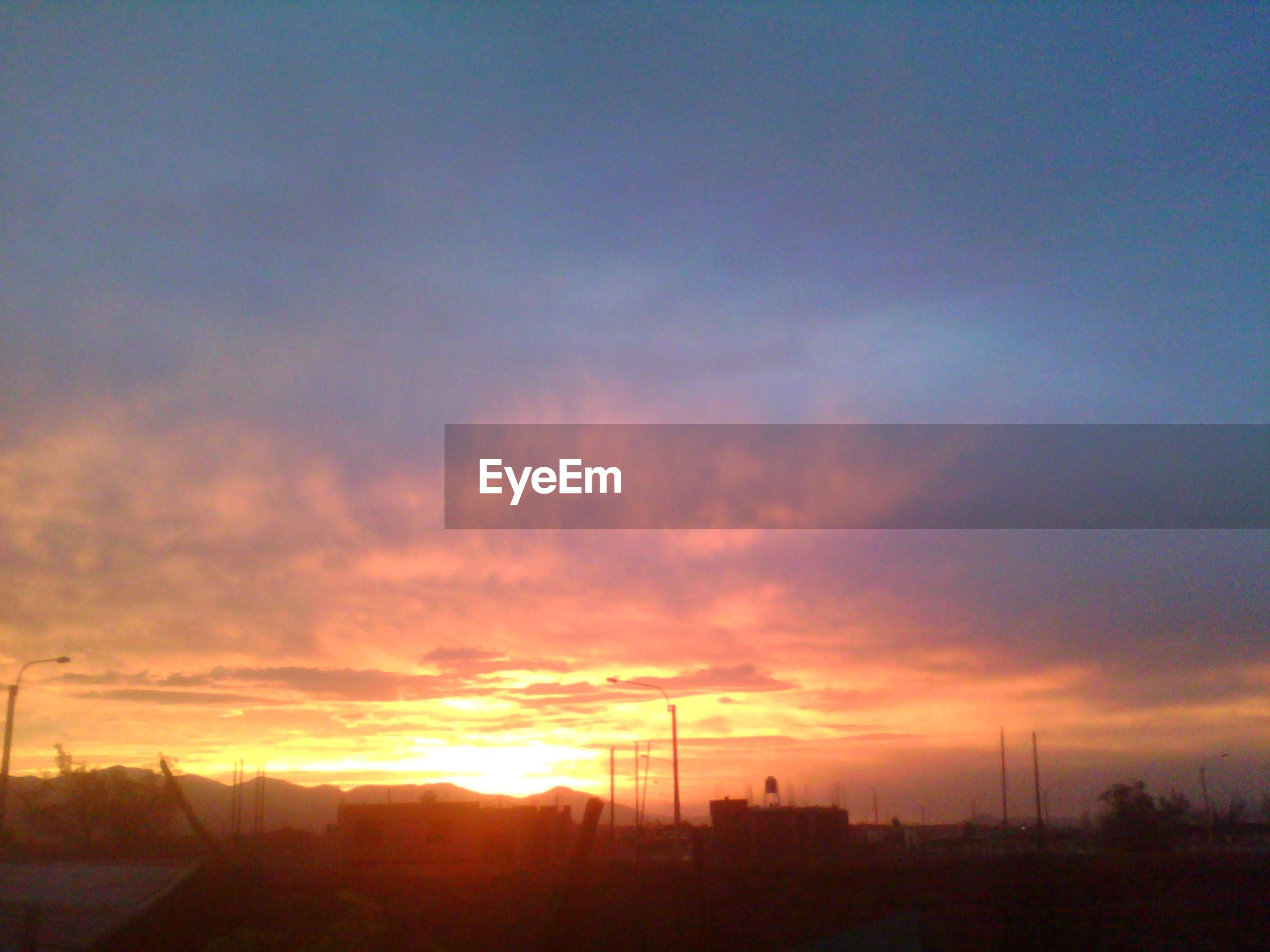 sunset, silhouette, sky, scenics, orange color, tranquil scene, tranquility, beauty in nature, landscape, nature, cloud - sky, idyllic, sun, cloud, field, sunlight, dramatic sky, outdoors, no people, non-urban scene
