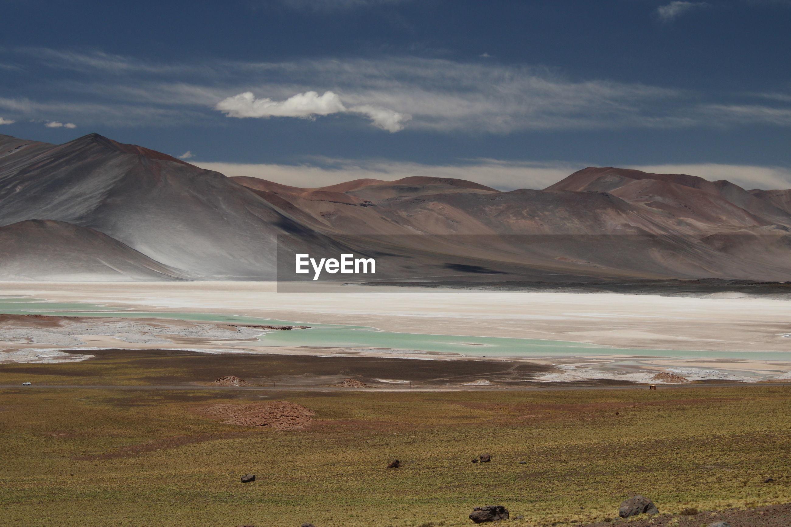 Red mountains and blue salty lagoon at piedras rojas, atacama desert, chile