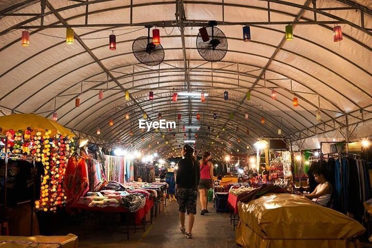 market, market stall, customer, large group of people, retail, lifestyles, store, people, business, indoors, night, food, adult, adults only, crowd