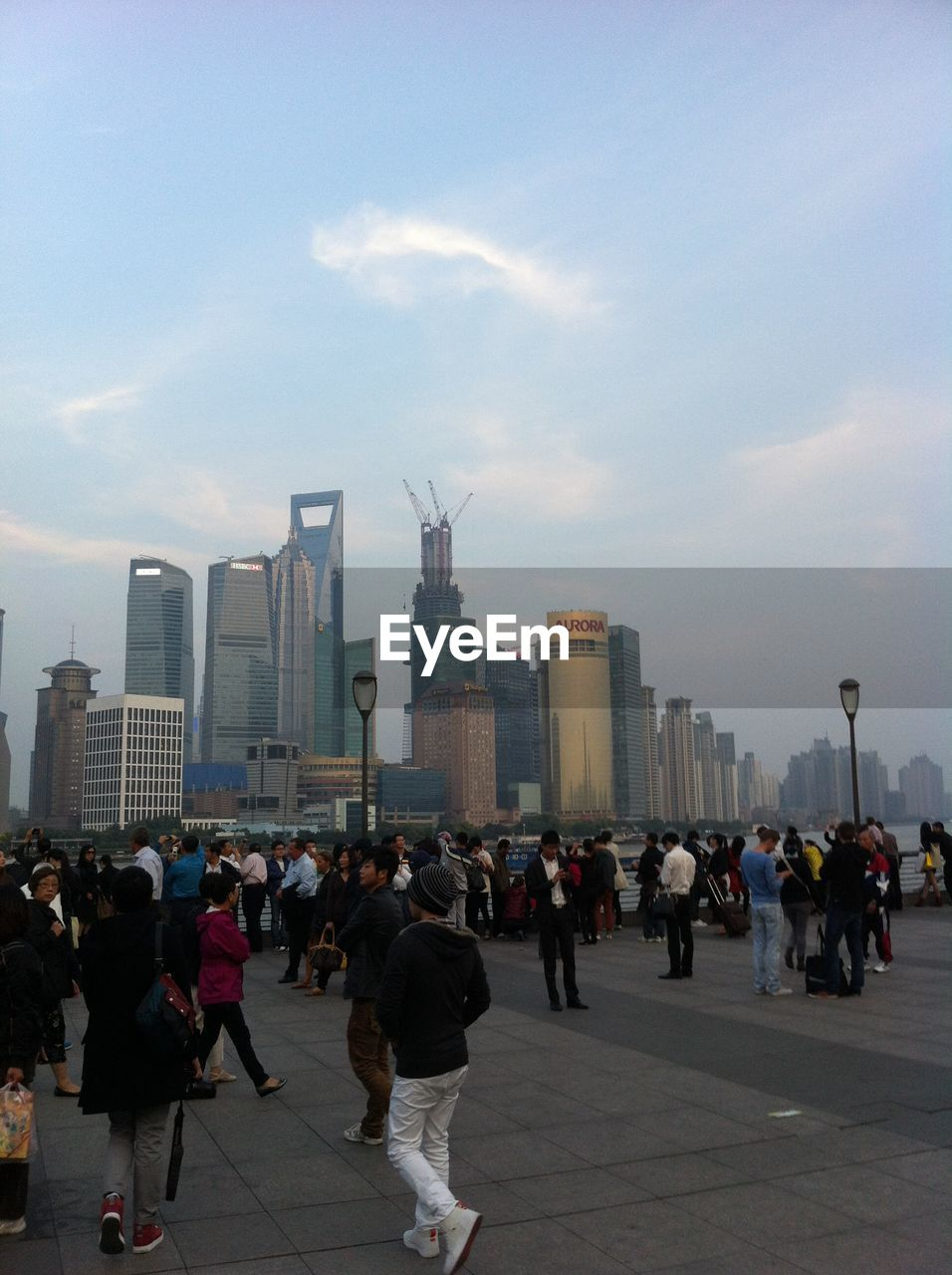 architecture, skyscraper, city, built structure, sky, modern, large group of people, building exterior, men, real people, outdoors, cityscape, day, people