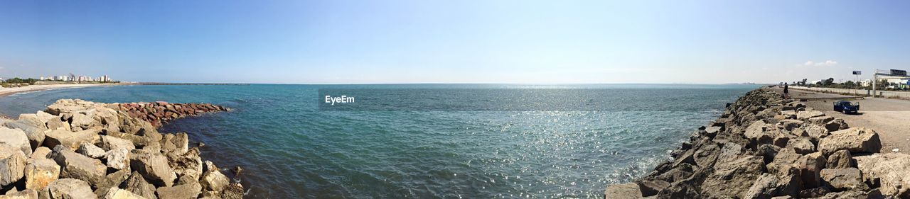 sea, water, rock, scenics - nature, sky, beauty in nature, rock - object, nature, solid, day, blue, tranquility, tranquil scene, horizon, horizon over water, sunlight, panoramic, rock formation, idyllic, no people, outdoors