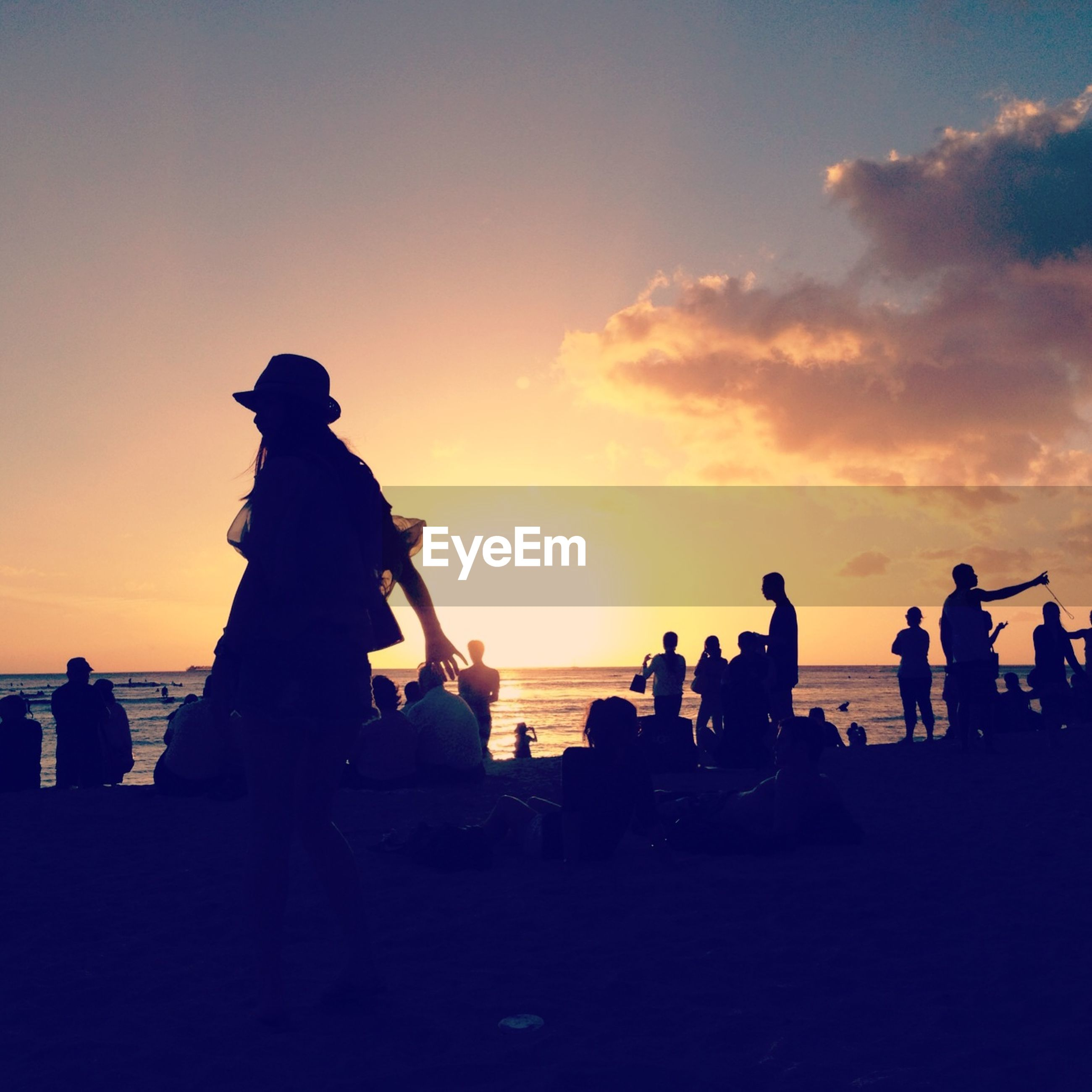 sunset, silhouette, sea, water, beach, horizon over water, sky, men, leisure activity, large group of people, lifestyles, togetherness, orange color, medium group of people, person, enjoyment, vacations, shore, sun