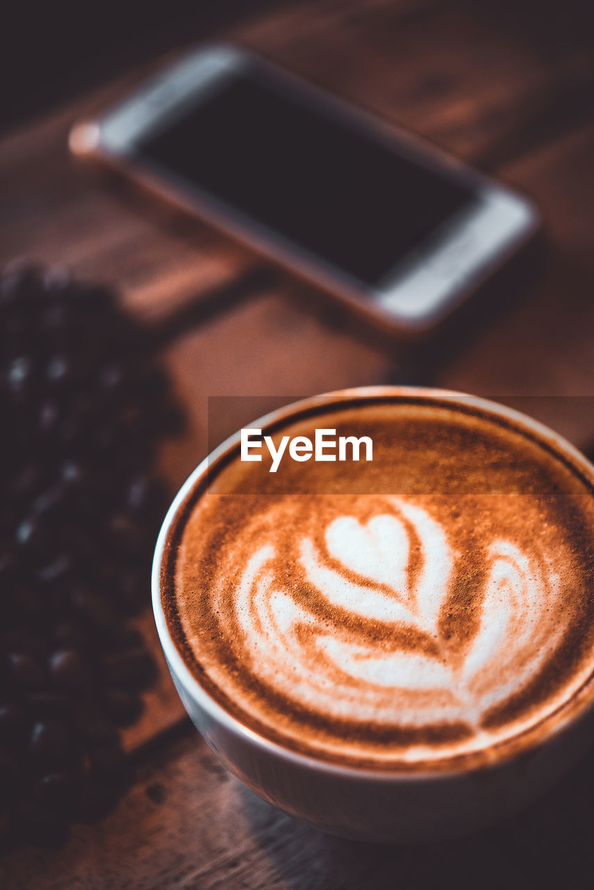 coffee - drink, cup, refreshment, drink, coffee, coffee cup, food and drink, mug, still life, frothy drink, cappuccino, table, high angle view, hot drink, froth art, indoors, close-up, creativity, crockery, wireless technology, no people, latte, froth, coffee shop
