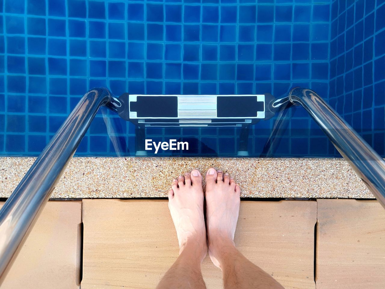 body part, human body part, barefoot, low section, human leg, personal perspective, real people, one person, human foot, lifestyles, leisure activity, relaxation, high angle view, directly above, pool, adult, women, day, swimming pool, flooring, human limb