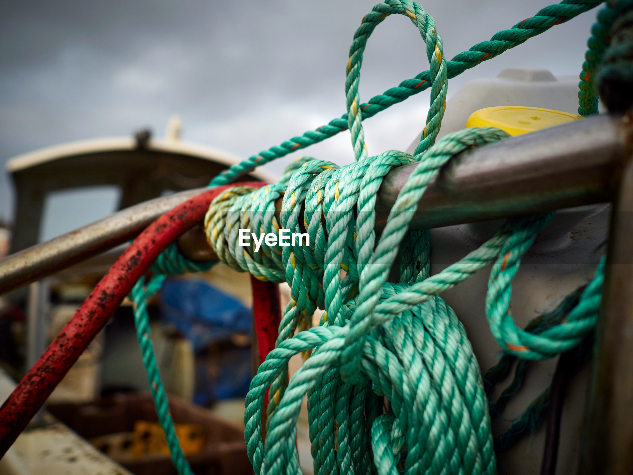 Close-up of rope tied to fishing boat