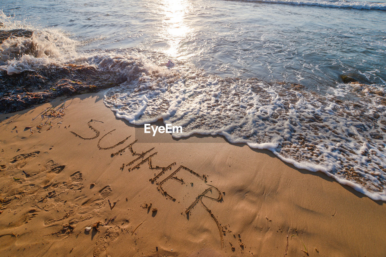 High angle view of text at beach
