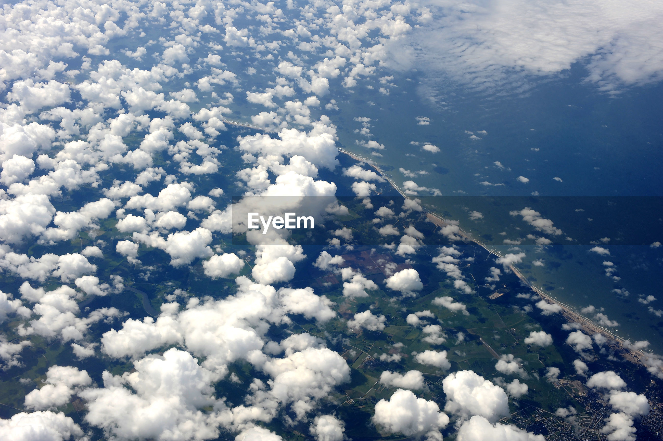 HIGH ANGLE VIEW OF CLOUDSCAPE OVER CLOUDS