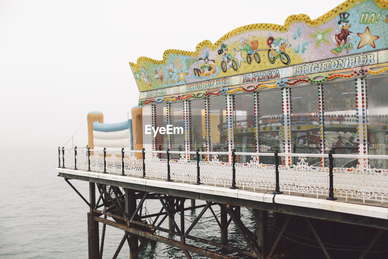 clear sky, no people, sea, amusement park, water, outdoors, sky, nature, day, carousel