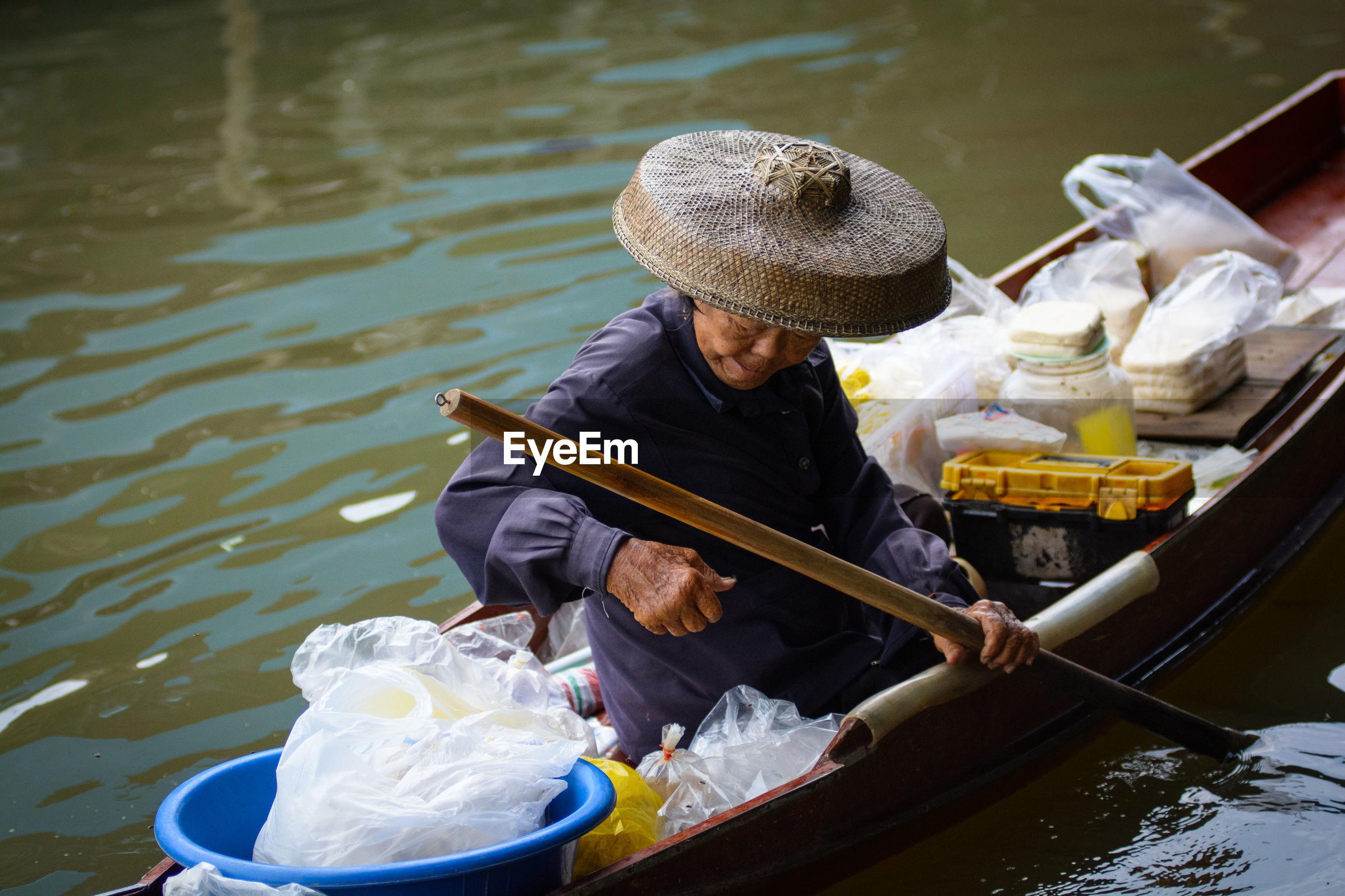 Man sitting on boat in lake