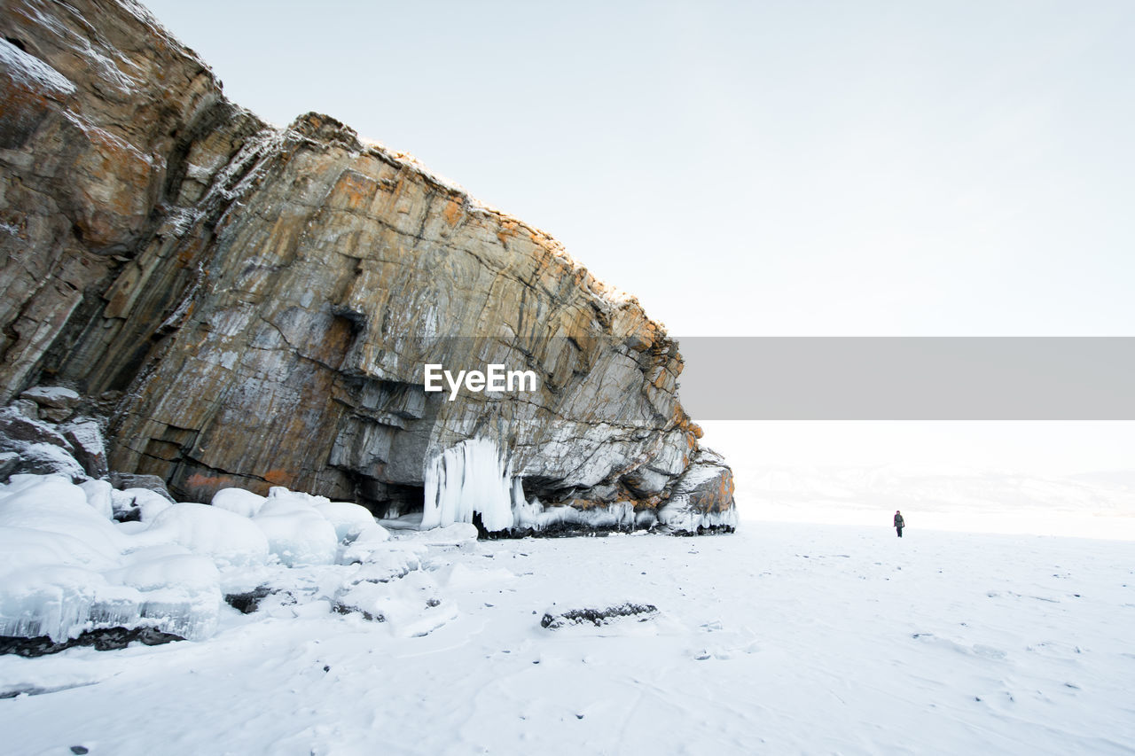 nature, rock - object, beauty in nature, rock formation, cold temperature, scenics, tranquility, clear sky, winter, day, outdoors, snow, no people, sky, water, iceberg