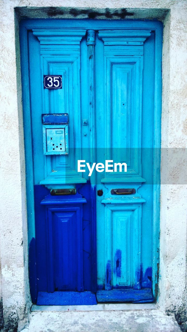 door, closed, blue, outdoors, no people, safety, day, architecture, close-up