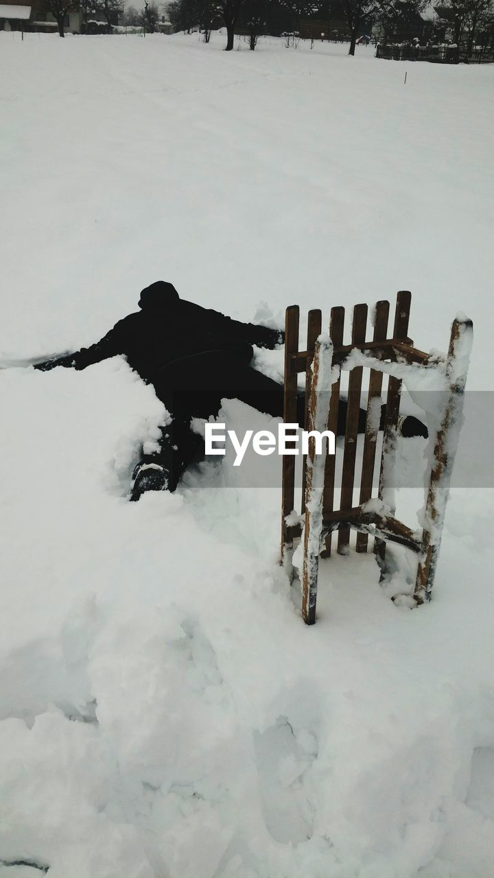 Person Lying On Front In Snow