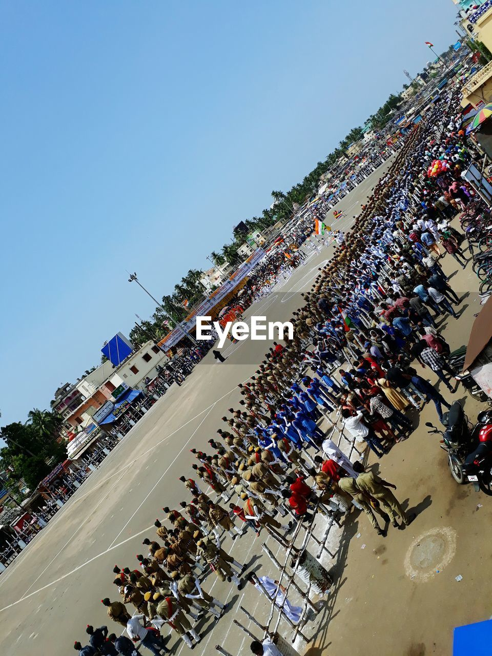large group of people, real people, crowd, men, day, clear sky, mixed age range, high angle view, outdoors, women, leisure activity, lifestyles, togetherness, audience, architecture, building exterior, tree, sky, people
