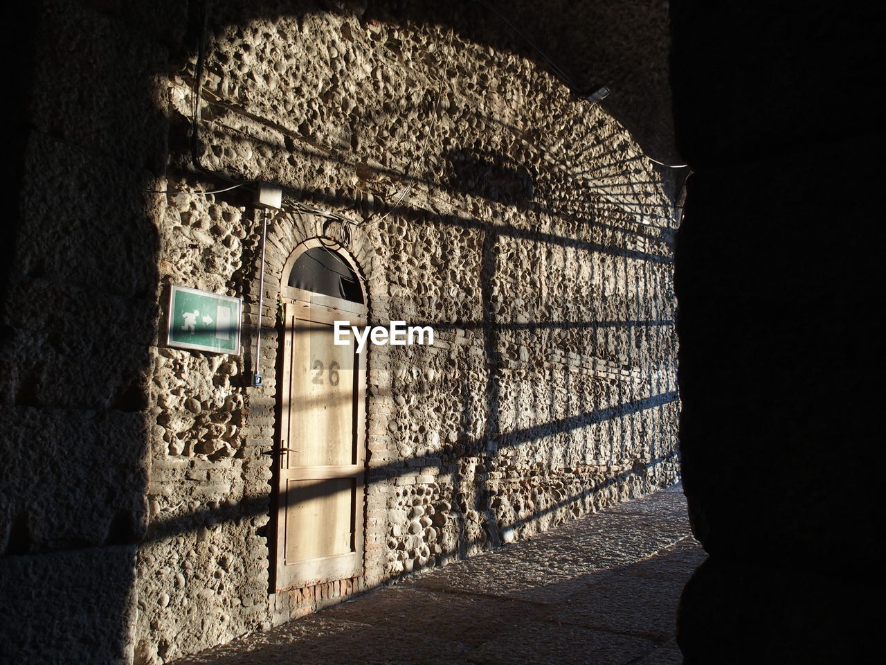 Shadow on stone wall in archway
