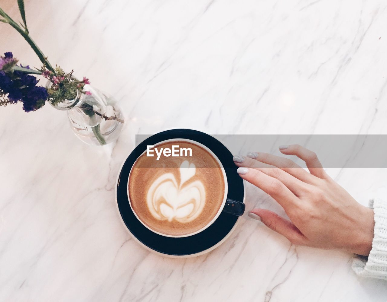 Close-Up Of Woman Holding Coffee