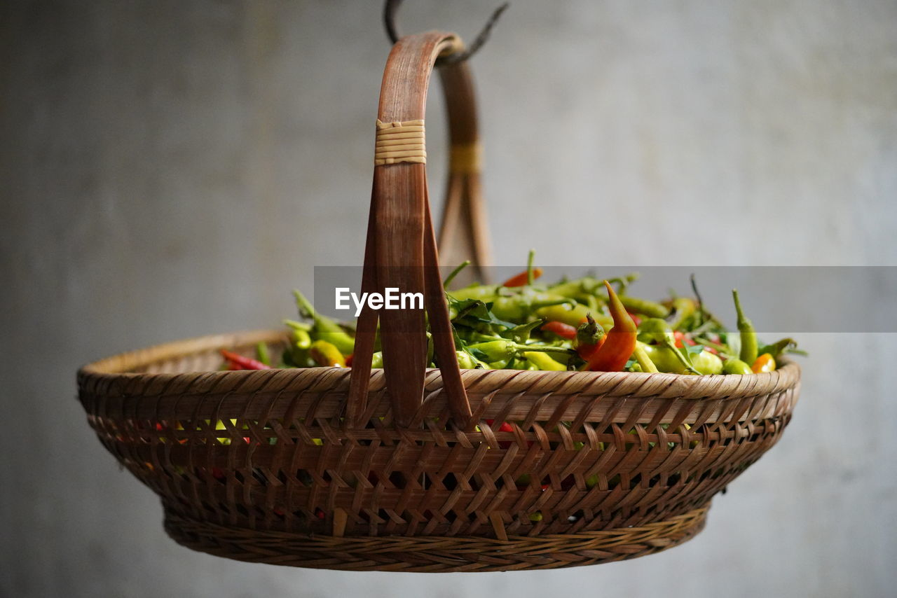 food and drink, food, container, freshness, vegetable, close-up, basket, indoors, focus on foreground, no people, table, still life, healthy eating, wicker, wellbeing, green color, raw food, large group of objects, selective focus, wall - building feature