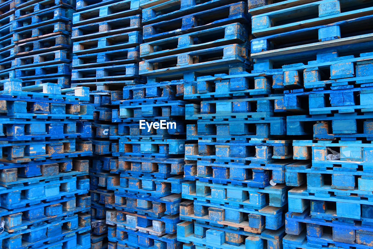 Full Frame Shot Of Blue Wooden Crates At Warehouse