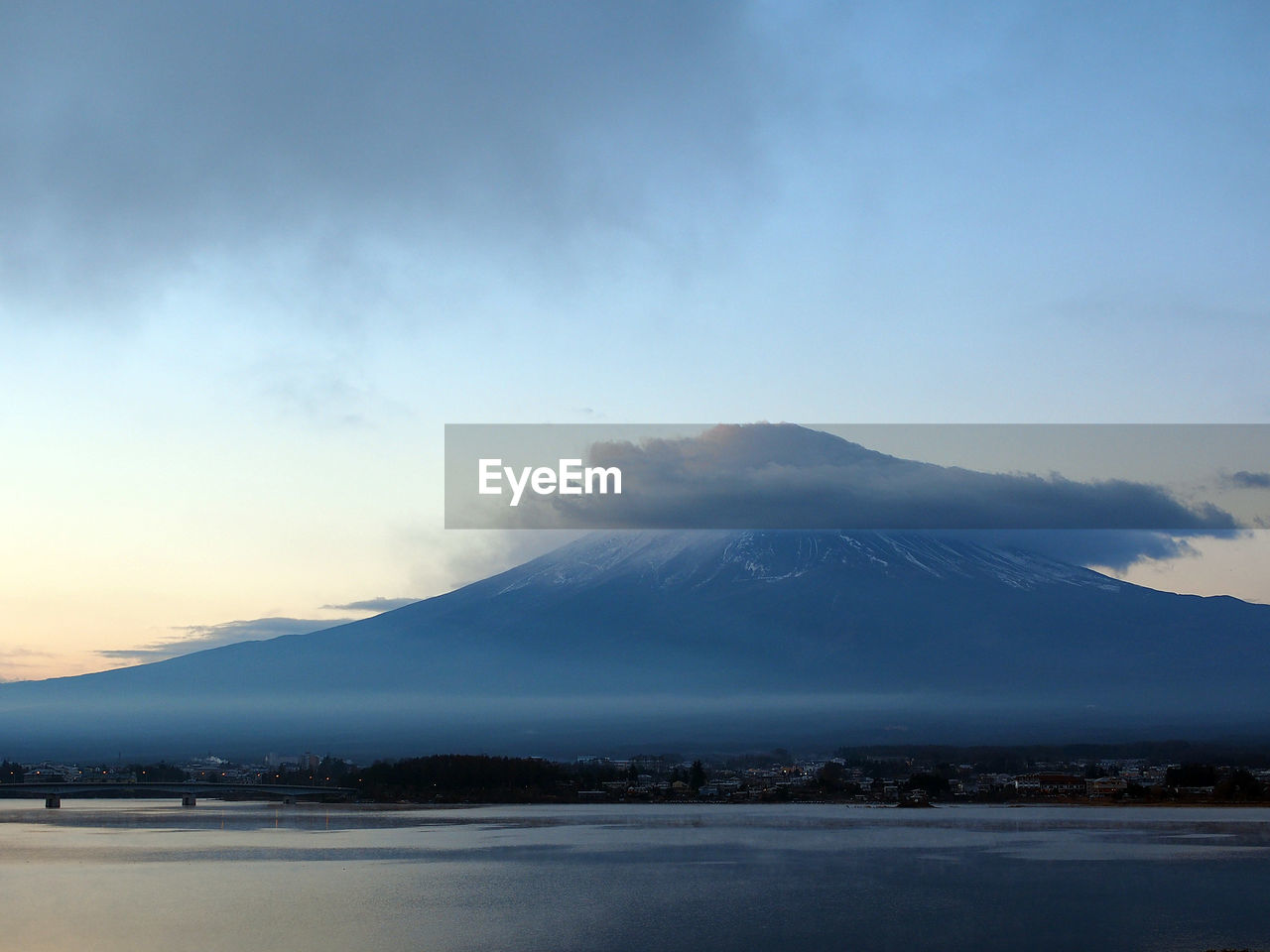 Scenic View Of Mount Fuji Against Cloudy Sky