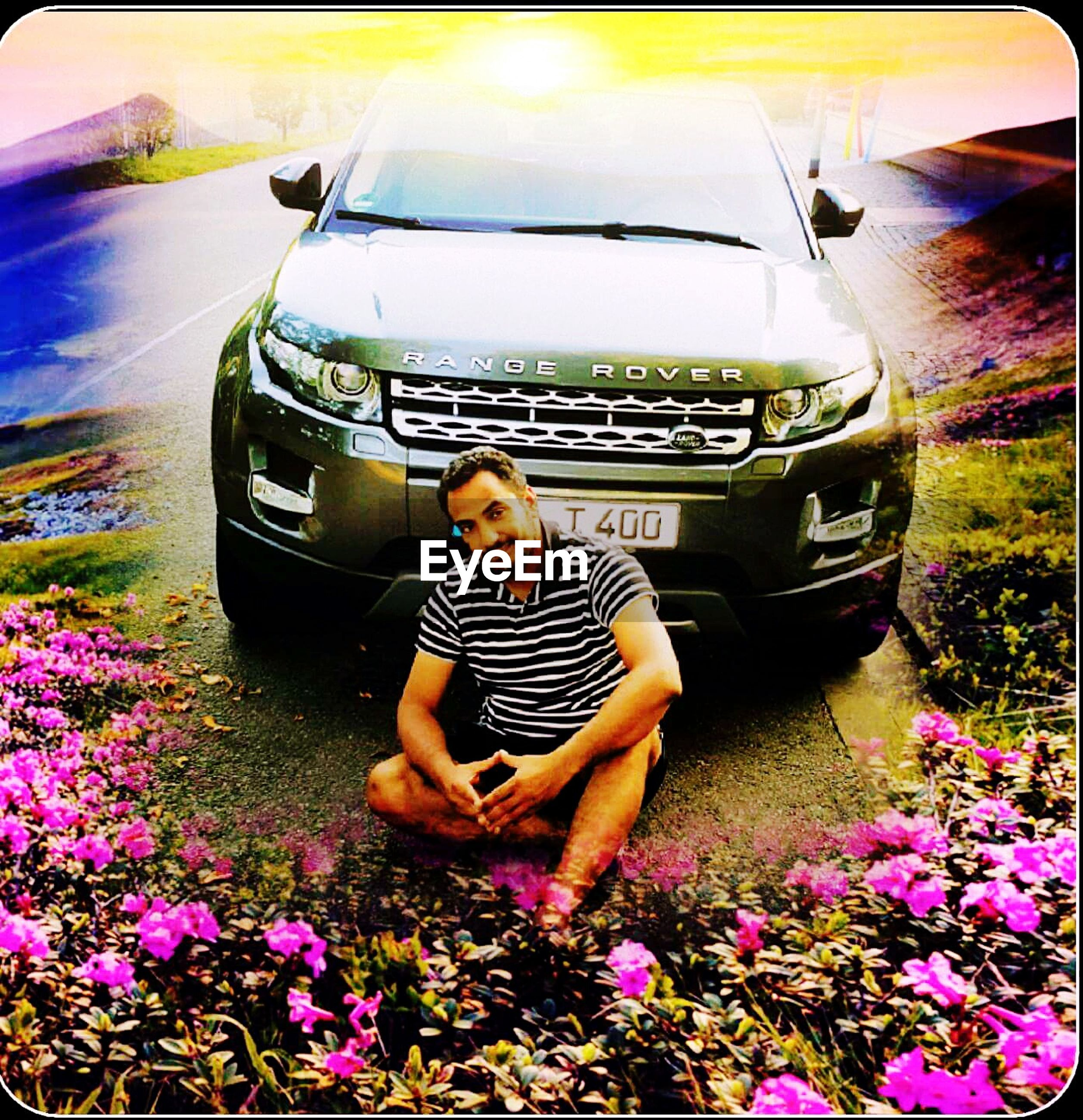 car, transportation, land vehicle, leisure activity, mode of transport, lifestyles, person, flower, casual clothing, front view, street, young women, full length, young adult, innocence, day, freshness, pink color, outdoors, fashionable, beauty in nature
