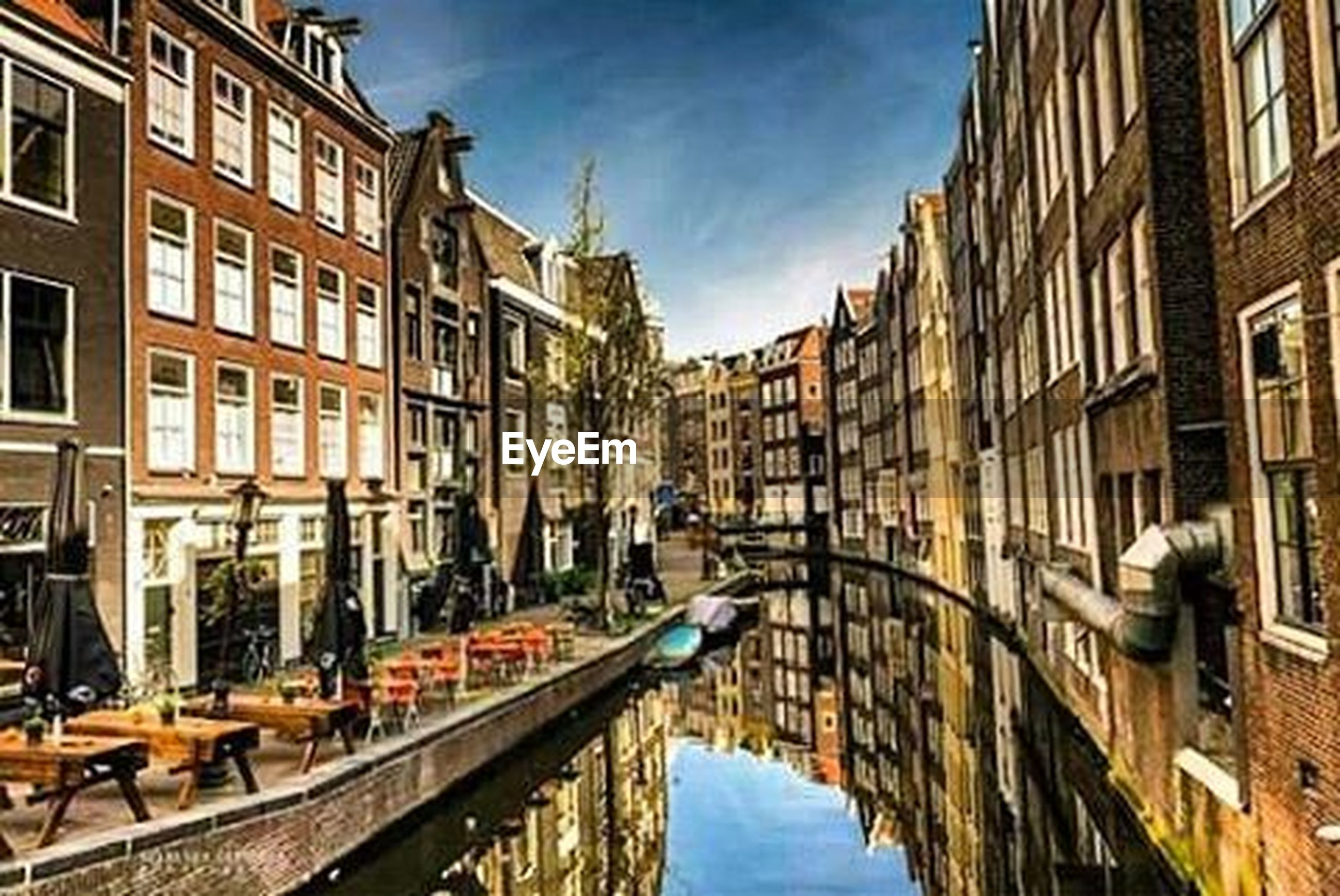 architecture, built structure, building exterior, water, canal, nautical vessel, boat, transportation, waterfront, moored, mode of transport, reflection, city, building, residential building, residential structure, sky, window, incidental people, day