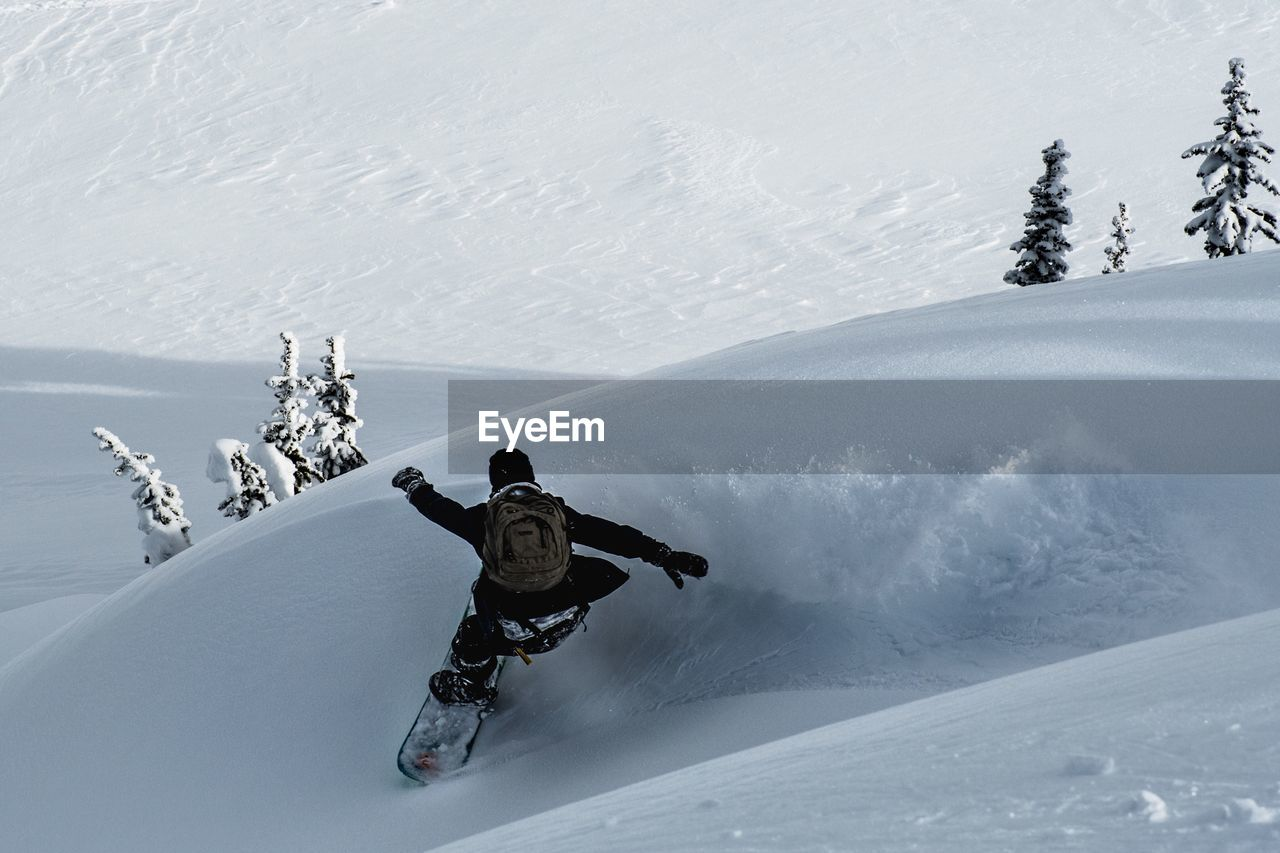 Man Skiing On Snow Covered Mountain
