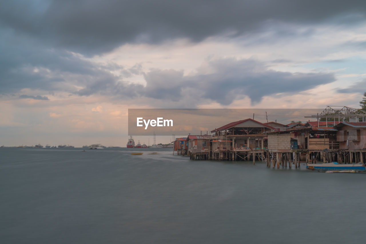 cloud - sky, sky, architecture, built structure, building exterior, water, building, waterfront, nature, city, beauty in nature, sunset, residential district, no people, sea, scenics - nature, transportation, outdoors, dusk