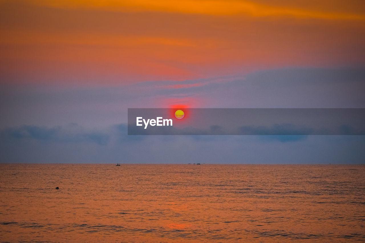 sky, beauty in nature, scenics - nature, sunset, tranquil scene, horizon over water, cloud - sky, sea, horizon, tranquility, water, orange color, idyllic, nature, sun, no people, non-urban scene, land, outdoors, eclipse