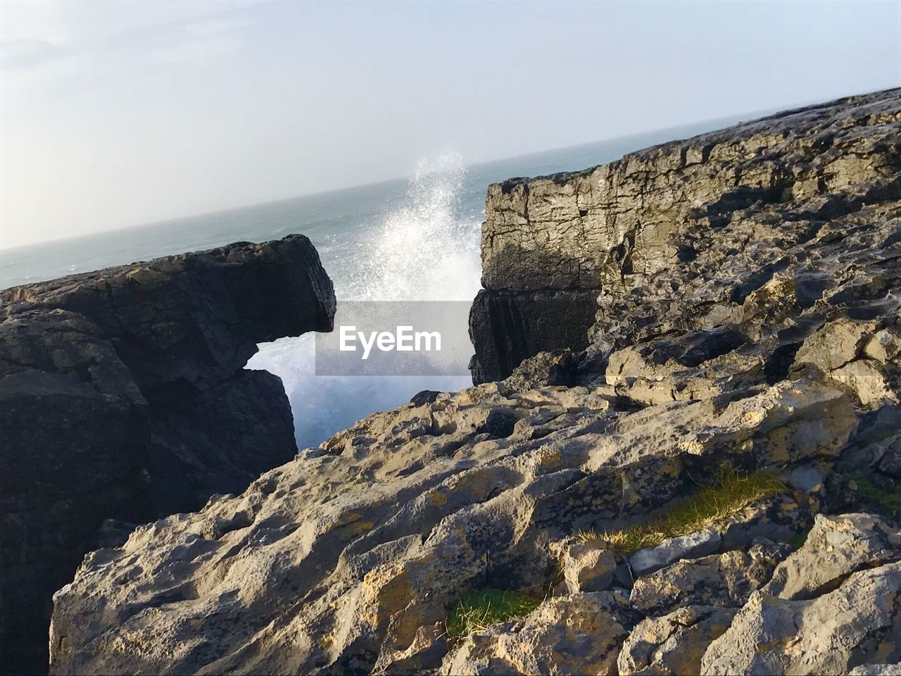 sea, water, rock - object, rock formation, nature, day, beauty in nature, cliff, horizon over water, no people, motion, scenics, clear sky, outdoors, sky, power in nature, crash, wave, force