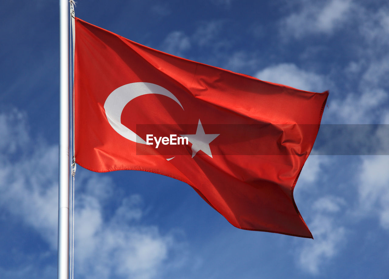 Low Angle View Of Turkish Flag Against Sky