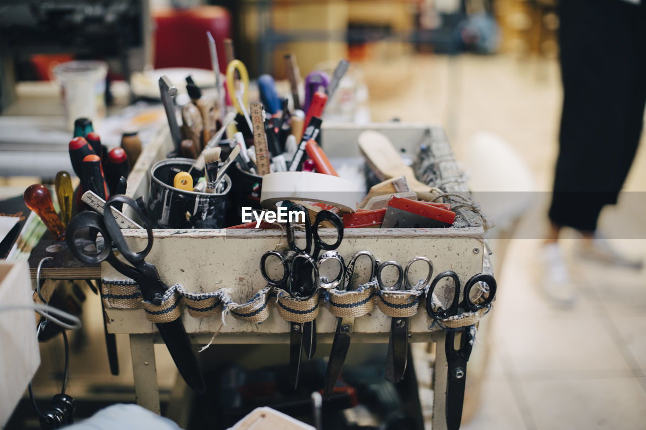 focus on foreground, indoors, large group of objects, close-up, still life, no people, equipment, table, group, workshop, metal, work tool, group of objects, selective focus, shopping, day, choice, container, high angle view