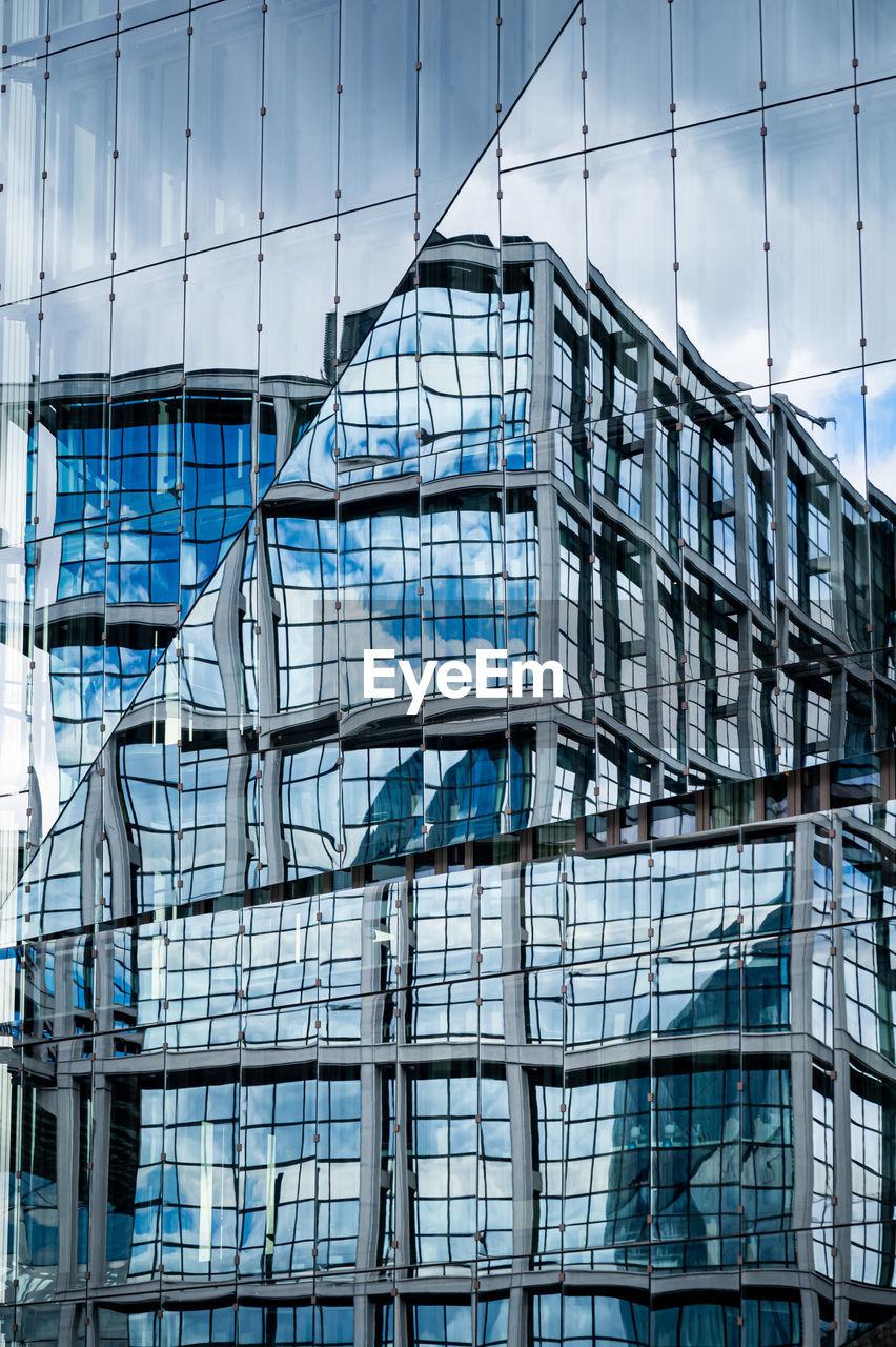 Full frame shot of modern building in city against sky